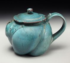 Small Turqoise Stoneware Teapot, wheel formed and altered, wood/soda/salt fired by David Voorhees