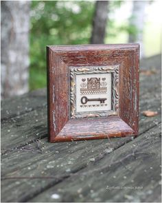 The frame and key really make this little piece look so lovely!