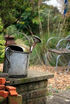 Antique watering can. Looks great with flowers in it!