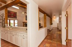 Halllway, kitchen and great room.
