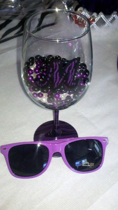 I made some hand-painted & initialed wine glasses as bachelorette favors in black/purple zebra.