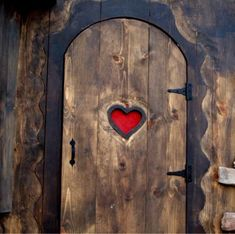 heart cut-out on wooden entry door.  I also see the heart as a mouth with two eyes above it.  Interesting design.