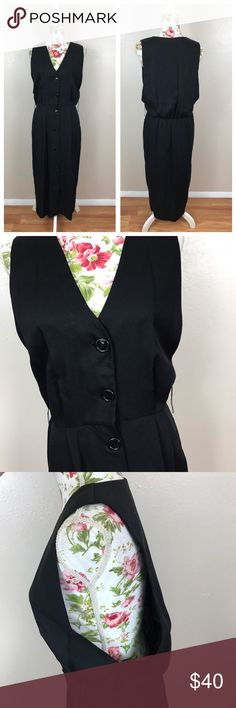 Vintage black button-down jumper style dress Absolutely stunning. Excellent condition. This does have loops at a belt around the waist however it did not have one when I received it. Lying flat and unstretched approximate measurements are bust open, sleeve hole 14 inches tall, waste 14 1/2 inches length 49 inches Vintage Dresses Maxi