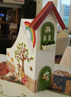 I would love to do this to my magazine holders! Then I would have a whole village in my craft room!