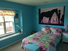Girls pink and blue horse room. I used baerhs cloudless paint, flat. Bedding and decor from Target. Horse picture came from Pottery Barn
