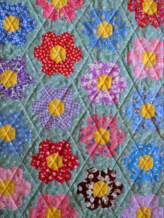 Grandmother's Flower Garden quilt, single flowers, 30s repro fabric.