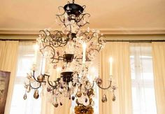 A tiered crystal chandelier in the home of Coco Chanel