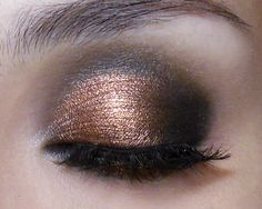 The #Black and #Copper #Noir eye. A 20s-style rounded smoky eye with a sculpted #metal twist. Tutorial and products in the link!  http://makeupbox.tumblr.com/post/46303647451/black-and-copper-smoke-eyeshadow-tutorial-this #makeup #tutorial #makeupbox #eyeshadow #beauty