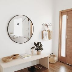 An oversized mirror makes a small entryway appear brighter and more spacious.