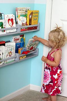 $3.99 Ikea spice racks!  I have been looking for book shelf for luke's room and this is better and cheap!