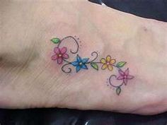 girly flower tattoo . . . foot?  ankle?