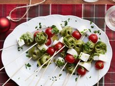 Tortellini Skewers   (18)  4 T olive oil  2 T jarred pesto 2 tsps red wine vinegar  2 pkgs spinach tortellini, cooked and cooled  2 pts cherry tomatoes  12 ozs fresh mozzarella, cubed   1/4 c minced fresh parsley  Read more at: http://www.foodnetwork.com/recipes/ree-drummond/tortellini-skewers.html?oc=linkback