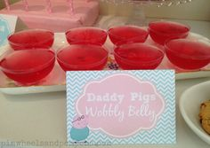 Daddy Pigs Wobbly Belly jelly cups at a Peppa Pig birthday party. Food tents available for purchase on Etsy