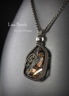 Very unusual stone, Astrophyllite, rough cut for this pendant.  One side was thick and clunky, the other thin and fragile,  I had to be very careful when wire wrapping this one.  Lisa Barth