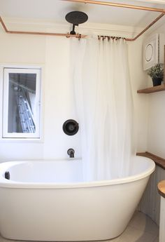 A 290 sq. ft. Tiny Luxury Tiny House with a Soaking Tub! Built by Handcrafted Movement in Battleground, Washington.