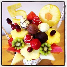 I made this Chocolate Sunny Days edible fruit bouquet for a 50th wedding anniversary celebration. What a fruity, delicious table centrepiece