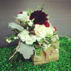 Christmas Centerpiece. Burgundy dahlias, snowberries, dusty miller, white roses