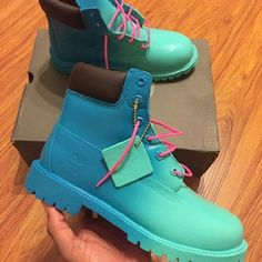 Mens blue timberland boots Custom Aqua shades blue with pink laces still have the box. Only wore once to take pictures. Too big selling these to get a smaller pair. Timberland Shoes Winter & Rain Boots