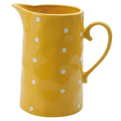Yellow polka dot pitcher