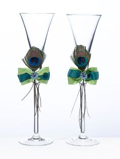 Wedding Peacock Feather Toasting Glasses. Perfect For The Peacock Wedding Theme. http://www.ceceliasbestwishes.com   Keywords: #peacockweddings #jevelweddingplanning Follow Us: http://www.jevelweddingplanning.com http://www.facebook.com/jevelweddingplanning/