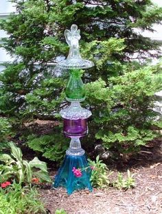 Decorations for the home and garden made with re-purposed heirloom and vintage glass:   Bird baths, pedestal cake stands, candle holders, centerpieces, garden art totems, and wedding cake stands.