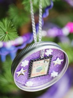 Use buttons to dress upcycled objects as ornaments. Here, a simple Mason jar lid was turned into a tree ornament by covering its interior with glitter paper and an assortment of decorative buttons.