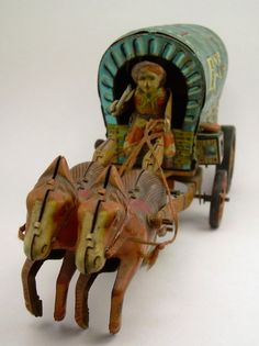 .tin covered wagon toy