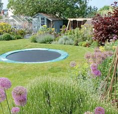 A Sunken Trampoline Surrounded By A Bank Of Grass