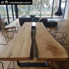#Repost @mandaleighcustom This stunning table which was on display in our Merilyn Project is Available for sale!!! One of a kind this unique Dining Table consists of 2 live edge Messmate slabs with a smoke grey toughened glass insert complimented by folded matt black steel legs. All finished in a natural matt oil that will guarantee to impress!!! 2700mm long x 1100 wide Matching chairs also available!!! Enquiries to @mandaleighcustom…