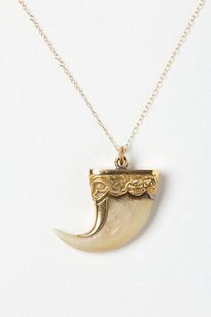 Revolting  - Anthropologie is selling  a tiger claw pendant under it's Estate and Vintage Jewlery.     Here's the editors note.      Dating to circa 1870 and sourced from India, this antique tiger claw is capped with serpent-engraved 18k gold. Undoubtedly fashioned after a belief in the auspicious symbol and its powers of protection, this one-of-a-kind find is from esteemed estate jewelers Doy