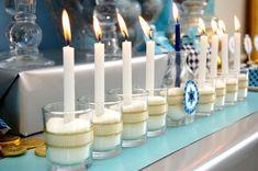 Hanukkah menorah ideas: DIY menorah made with jars, sugar ribbon and candles on Frog Prince Paperie.
