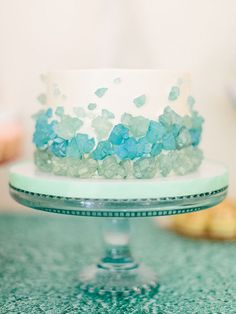"blue ""rocks"" on cake, ocean-themed first birthday cake, blue and green smash cake"