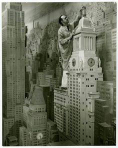 """Con Edison """"City of Light"""", 1939 NY World's Fair was called """"The World's Largest Diorama."""" It was taller than a 3 story building and extended the length of a city block. The animated model used music, sound effects, and narration, to show visitors the role in supplying NY with steam, gas, and electricity during 24 hours."""" It is initially presented with a dark sky with lightning looming over N Y and the windows of the buildings lit up, brightening NY."""" http://architecturalogy.com/"""