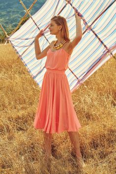 The Peachtree Dress by Paper Crown offers a modern take on a classic style, in a cheerful peach shade.