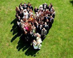 An overhead photo of the wedding guests in the shape of a heart.