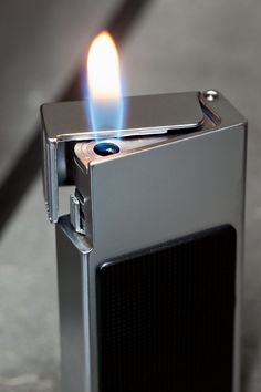 Braun lighter by Dieter Rams. Photography by Florian Bohm as featured in 'As Little Design as Possible' Id Design, Design Blog, Retro Design, Famous Product Designers, Little Designs, Cool Designs, Cool Lighters, Cigar Lighters, Dieter Rams Design