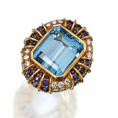 AQUAMARINE, SAPPHIRE AND DIAMOND RING, MOUNTED BY HARRY WINSTON