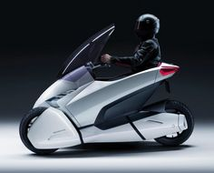 The Honda is one radical new way to solve the climate crisis. Honda reckons the concept bike, about to go on display at the Geneva Motor Show, is the Microcar, Electric Car Concept, Electric Cars, Electric Vehicle, Electric Tricycle, Futuristic Motorcycle, Futuristic Cars, Futuristic Design, Concept Motorcycles