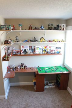 "One Saturday morning in late July, I went to the ""Lego room"" and decided we needed a change. We had built a Lego table a year and a half a. Lego Shelves, Lego Storage, Storage Ideas, Basement Storage, Storage Shelves, Lego Display, Lego Wall, Modern Murphy Beds, Home Entertainment Centers"