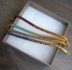 Handmade delicate bracelet with gold plated beads. All bracelets are handmade with Miyuki beads. This bracelet is made with the smallest size beads, size These gold beads are 24 carat gold plated beads. Miyuki beads are from high quality and this brac Bead Loom Bracelets, Dainty Bracelets, Layered Bracelets, Handmade Bracelets, Diamond Bracelets, Dainty Jewelry, Earrings Handmade, Gold Jewelry, Jewelry Bracelets