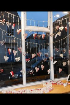 Wonderful valentines window display at Sue Foster Interiors Emsworth using wallpaper hearts. <3