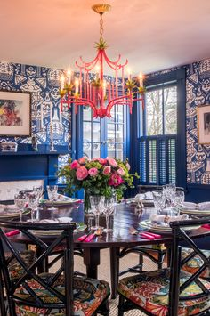 Meggie H. Interiors chinoiserie blue and white dining room with pink chandelier.  New England Meets Palm Beach