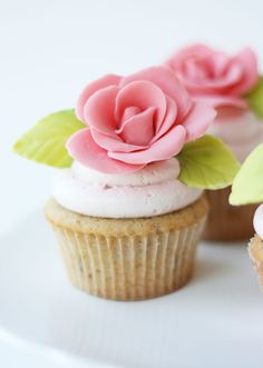 Almond Rose Cupcakes with Strawberry Mascarpone Buttercream ~ Says: The addition of mascarpone to the buttercream gives the icing a light whipped-cream like texture and the strawberry adds a fruity vibrancy