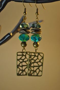 Hey, I found this really awesome Etsy listing at http://www.etsy.com/listing/112156319/teal-blue-czech-glass-earrings-with