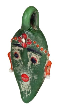 Glass face pendant with decorative details in orange, red, ivory and black. Completely made from fused pieces of glass. 400-200 BC.