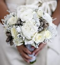 bouquet with roses, peonies, pine cones, and some little grey berry