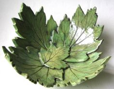 Lime green hydrangea leaf bow made from rolled out slabs of clay impressed with actual leaves. could do with modified concrete too Hand Built Pottery, Slab Pottery, Pottery Bowls, Ceramic Pottery, Pottery Art, Leaf Projects, Sculptures Céramiques, Leaf Bowls, Green Hydrangea
