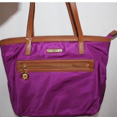 """SALE TODAY ONLY MK-Kempton Tote in Fuchsia Beautiful Color!!  Medium Nylon Tote in very Good condition, inside spotless, Exterior clean, bottom of bag shows signs of ware as shown in picture, on 2 corners, not noticeable Bag is made of Synthetic and leather.  Nylon Trim and Handles Leather. Double shoulder straps with 10"""" handle drop, One Zip Front Pocket.  Inside has 1 zip pocket and 3 slip pockets, 1 cellphone pocket & key hook Medium Size Tote,  Measurements: 14 1/2"""" W x 9 1/2"""" H x 41/2""""…"""