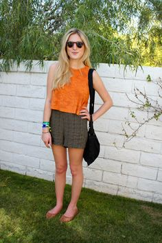 Coachella Fashion! 60+ Rockin' Style Snaps #refinery29  http://www.refinery29.com/2011-coachella-fashion-street-style-at-coachella#slide17  Orange Alert—Nothing like a pop of color to punch up a simple outfit.