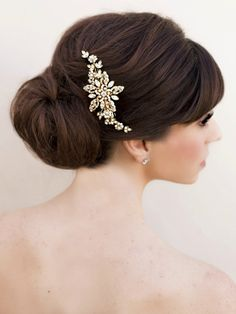 Vintage inspired gold flower bridal hair clip accented with freshwater pearls in a low bridal bun by Hair Comes the Bride.